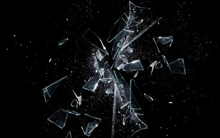 glass breaking with black background